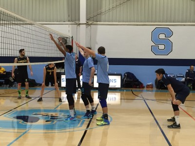 Team anticipating a serve from their teammate