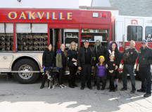 Oakville's firefighters stopped by to have fun with the cute pups.