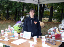 Amanda DaSilva-Prett, a four year volunteer with The Dog Rescuers Inc. helps set up the booths in preparation for the day's adventures.