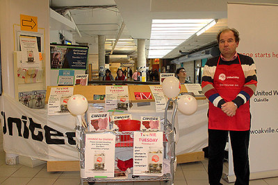 Terry Kostiw collects money for Toonie Tuesday for the United Way of Oakville