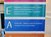 A sign at the YMCA of Oakville's Community Breakfast for Peace informs people that PEACE stands for participation, empathy, advocate, community and empower.