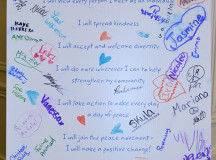 The YMCA peace week pledge for peace is full of signatures from people who will promise to promote peace.