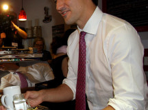 Trudeau hands another coffee out to a Liberal supporter.