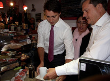 Liberal candidate for Oakvile, John Oliver (right), helps Trudeau.