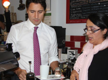 Yury Wu teaches Trudeau about coffee.
