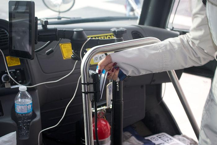 A Trafalgar student swipes their one car to board the shuttle bus this week.