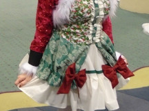 "Kristy Manuel created her costume herself, and was inspired by ""wanting an excuse to design and sew a tacky Christmas dress""."