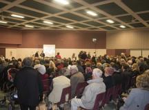 (Residents await the meeting of Syria Action Burlington at Mainway Auditorium)