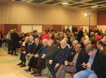 (Burlington residents await the discussion period)