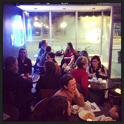 Photo Credit: Lisa Kannakko. (Death Cafe attendees enjoy some food and drink over conversations of death and  anything related.)