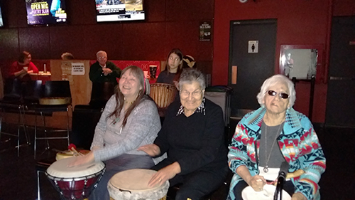 From left to right: Vina Augustine, Bertha Skye, Anita Laing, enjoying their time at the Drum Circle. Photo by Paula Laing.