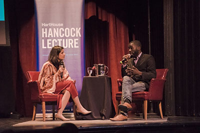 Azeezah Kanji, left, and Desmond Cole, right, discuss systemic racism and the security state at the annual Hancock Lecture at U of T's Hart House. (Photo Credit: Jiduo An)