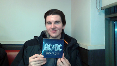 Blake Johnson holds up a copy of his favourite album, Rock or Bust.