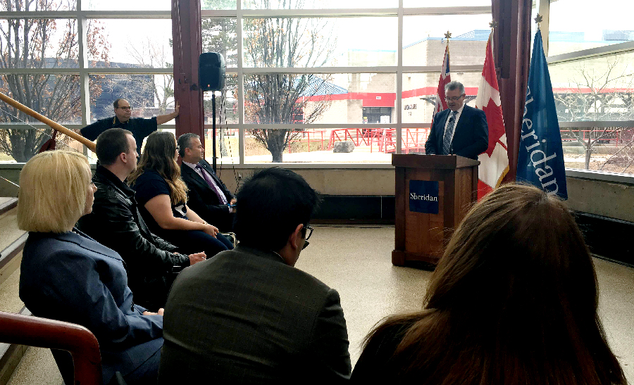 MPP Kevin Flynn speaks to faculty and students at Sheridan's Trafalgar campus on Mar. 15