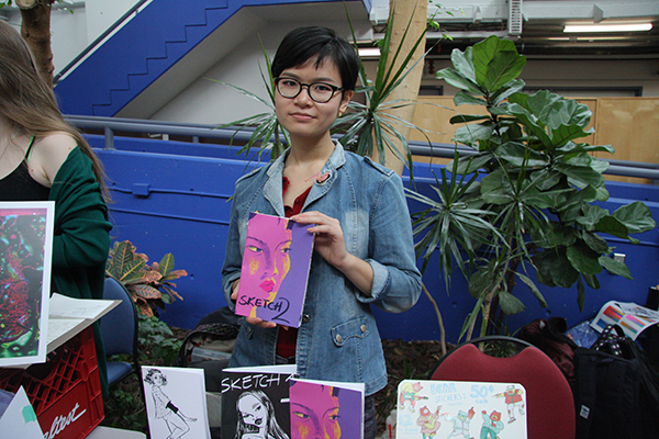 Second year Illustration Ashley Wong displaying  her zines and stickers. She first heard about the art of zineing at TCAF.
