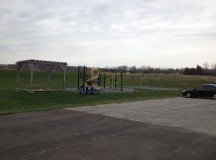 The playground where kids have recess. Further back is a ball field where they can play baseball.
