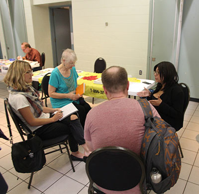 "Activists-in-training take part in discussion group led by the Council of Canadians. Various groups set up stations around the hall in a ""World Café style"" event."